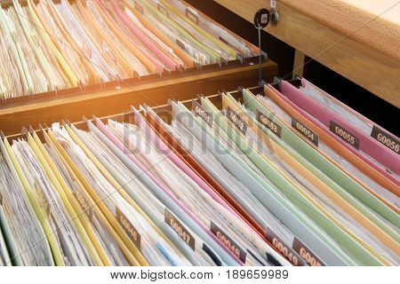Financial documents colorful stored in filing cabinets.
