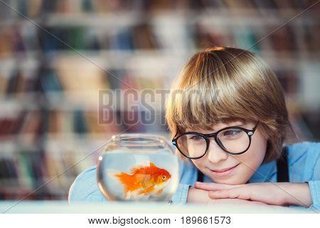 Smiling child with aquarium
