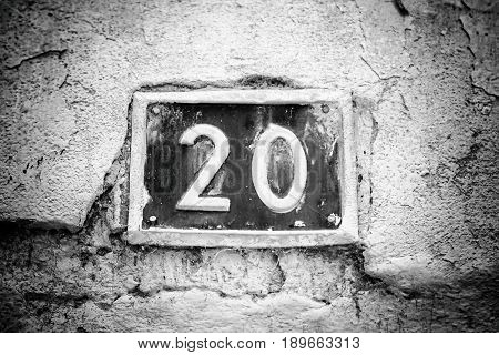 Number Twenty On The Wall Of A House