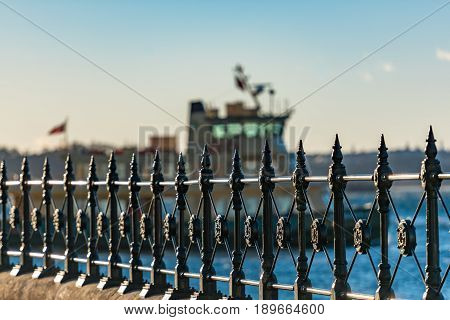 Cast iron railings at Circular Quay and ferry on the background. Selective focus on railings. Sydney Australia