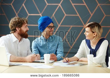 Group of intercultural co-workers having discussion
