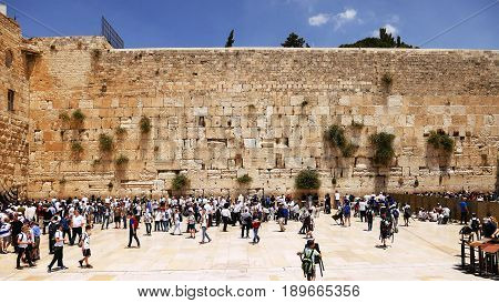 Western Wall or Wailing Wall or Kotel in Jerusalem timelapse. Plenty of people come to pray to the Jerusalem western wall. The Wall is the most sacred place for all jews on the planet.