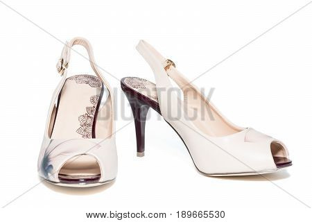 The photo shows female beige shoes on a white background
