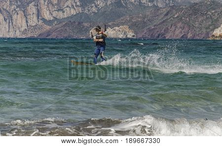 Porto Paglia Italy - October 03 2016: Senior person keeps active by practicing kitesurf