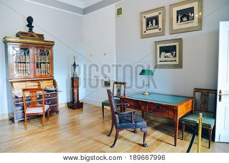 Ostafyevo, Moscow region - May 13, 2017 - Princely cabinet in an old mansion 18-19 centuries. Desk, armchair,bureau with a library, paintings, sculpture. Old furniture from Karelian birch and leather.