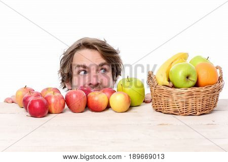 Caucasian Man With Cunning Look Near Red Or Green Apples