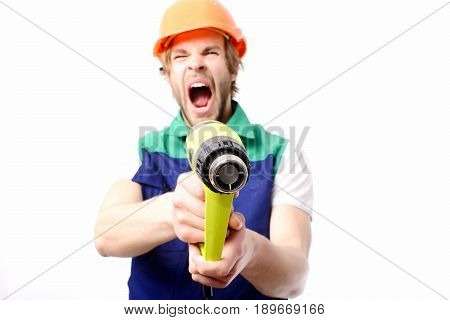 Builder with tool. Contractor with brutal face screaming and holding yellow construction tool as gun pretending to shoot isolated on white background. Building and hard work concept