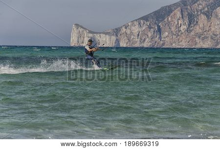 Porto Paglia Italy - October 03 2016: Aged person keeps active by practicing extreme sport