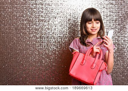 Small Cute Smiling Girl With Red Leather Bag, Mobile Phone
