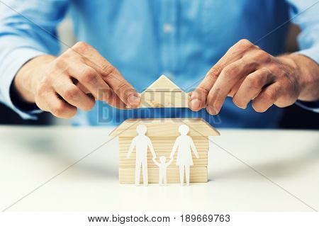 house mortgage concept - bank salesman help family to get new home