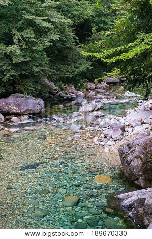 Crystal clear blue water of river in forest.Ookuwa Nagano prefecture Japan