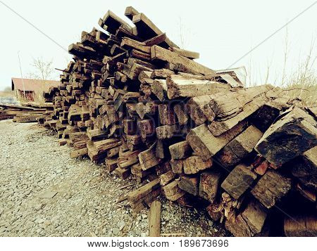 Terrible Smell Pile Of Extracted Old Wooden Ties. Old Oiled Used Oak Railway Sleepers Stored
