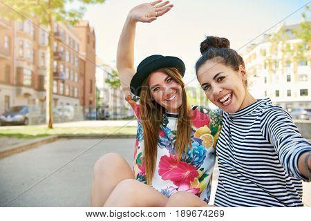 Vivacious Friendly Young Women Waving