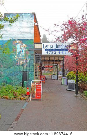 LEURA AUSTRALIA - SEPTEMBER 25 2015: Shops and mural along Leura Mall the main thoroughfare through Leura a rural gateway to the Blue Mountains of New South Wales Australia on a rainy spring day.