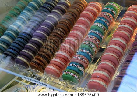 Large tray filled with just baked macaroons in several flavors