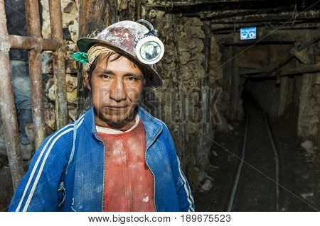 Potosi Bolivia - November 29 2013: One miner at the entrance of the silver mine of the Cerro Rico in Potosi Bolivia.