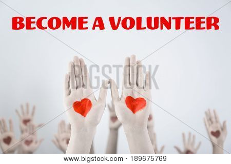 Text BECOME A VOLUNTEER and people raising hands on color background. Concept of support and help
