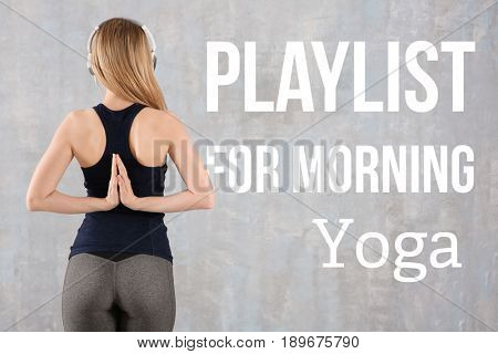 Young woman listening to music during yoga practice, color background. Concept of melody for meditation