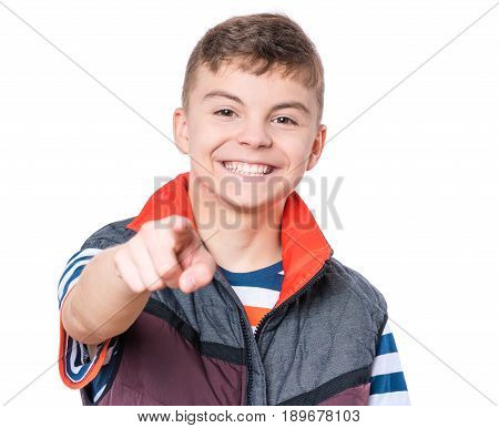 Half-length emotional portrait of caucasian teen boy. Funny teenager pointing at camera choosing you, isolated on white background. Handsome happy child pointing finger to you.