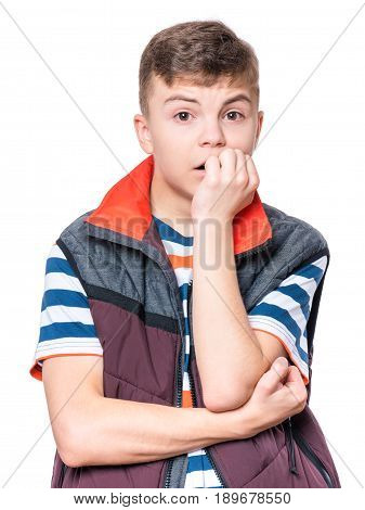 Half-length emotional portrait of caucasian teen boy. Surprised or scared teenager looking at camera. Handsome child, isolated on white background.