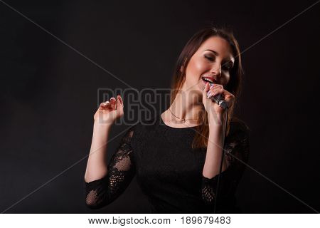 Girl in dress with microphone