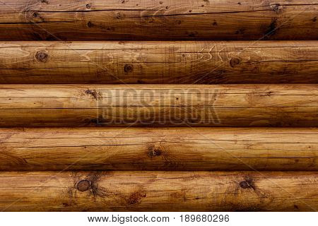 Wooden Wall From Logs As A Background.