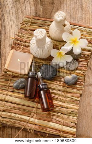tropical spa treatment on mat with wooden background
