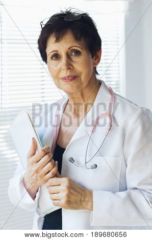 Caucasian doctor holding clipboard in office