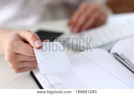 Female Hand In Suit Give Blank Calling Card To Visitor Closeup