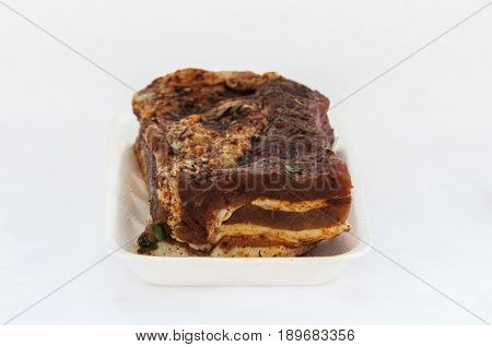 A piece of bacon isolated on white background