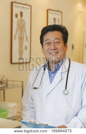 Chinese doctor smiling in office