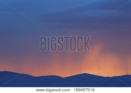 Colorful sunset over rural mountains