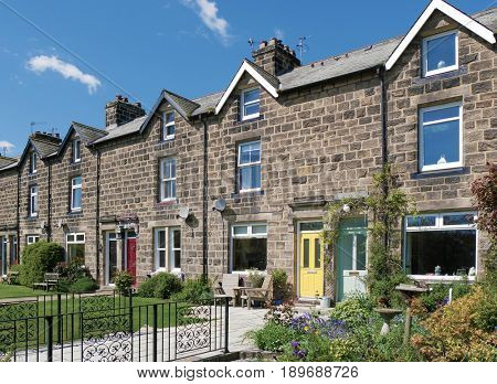 Row of English terraced houses with front gardens