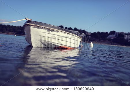 Old rowing fishing boat on the sea