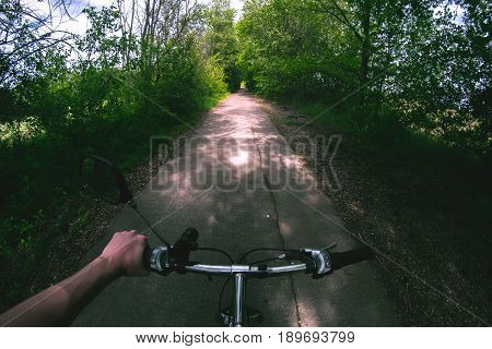 Hand on the wheel of a bicycle on the road