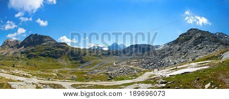Beautiful panoramic view on Swiss Alps, Alpine green mountains hills, walking tourists, amazing blue sky clouds. Touristic ways paths to sightseeing viewpoint. Swiss holidays vacations. Corvatsch
