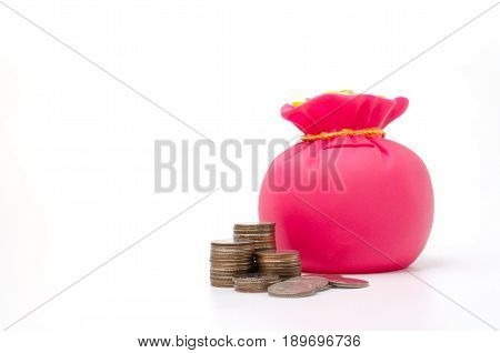 Piggy bank or money bag shaped money box with coins on white background in saving money concept copy space