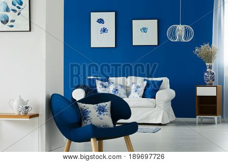 Sofa And Chair With Flowery Pillows