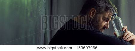 Hopeless Man Holding Alcohol Bottle