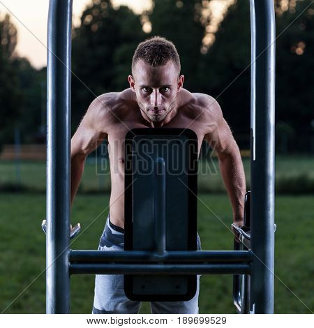 Muscular man pulling up on excercise machine