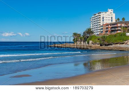 Cronulla Beach And Coastline With Waterfront Buildings On Sunny Day