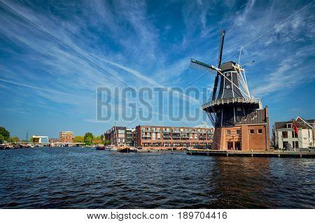 View of Harlem landmark windmill De Adriaan on Spaarne river. Harlem, Netherlands