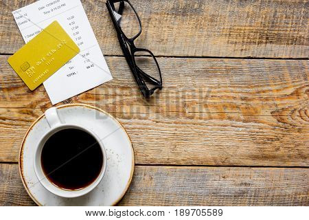 Credit Card For Paying, Coffee And Check On Cafe Wooden Desk Background Top View Mock Up