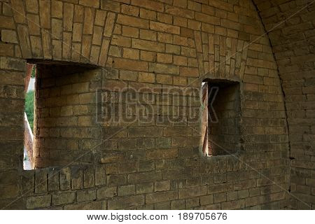 Gun loopholes in the brick wall of the fortification of the nineteenth century The Kiev Fortress