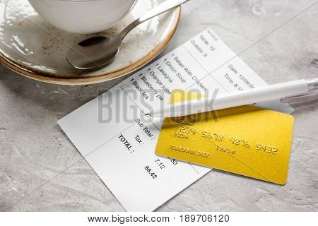Credit Card For Paying, Coffee And Check On Cafe Stone Desk Background
