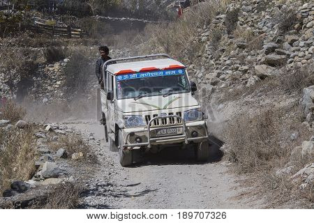 HIMALAYAS ANNAPURNA REGION NEPAL - OCTOBER 16 2016 : Jeep is the primary means of transport in Himalayas. People try to reach their destination driving through the mountain road on trekking path