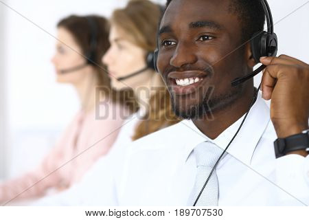 African american call operator in headset. Call center business or customer service concept.