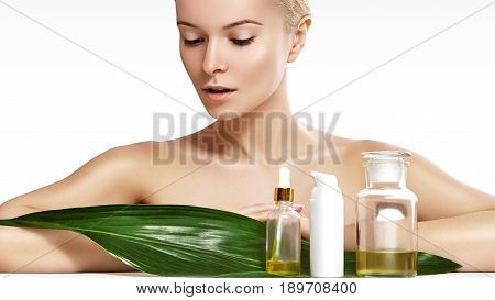 Beautiful Woman Applies Organic Cosmetic And Oils For Beauty. Spa And Wellness. Clean Skin, Shiny Ha