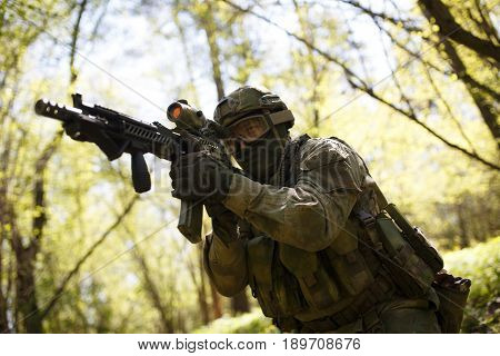 Officer aims keeping machine gun in forest on mission