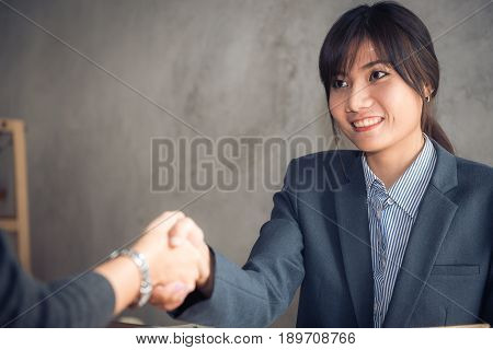 Negotiating businessImage businesswomen handshakehappy with workbusiness woman she is enjoying with her workmateHandshake Gesturing People Connection Deal Concept. Vintage effect style pictures.
